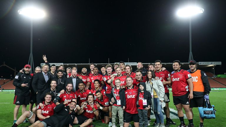 The Crusaders celebrate after Wyatt Crockett (front, flanked by kids) tasted victory on the occasion of his 200th Super Rugby game