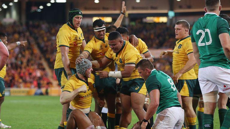 David Pocock celebrates after scoring for Australia