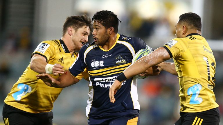 Folau Fainga'a takes on the Hurricanes defence