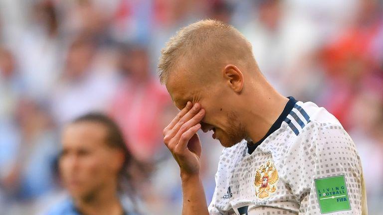 Igor Smolnikov reacts to being sent off