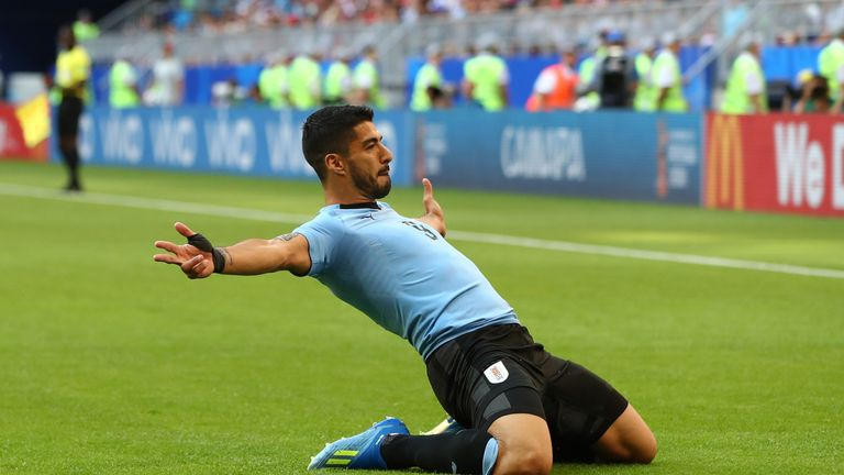 Luis Suarez drops to his knees in celebration after giving Uruguay the lead
