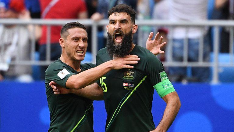 Mile Jedinak celebrates after scoring his penalty on Thursday