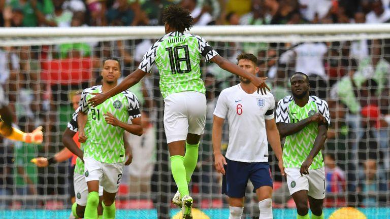 Nigeria midfielder Alex Iwobi (centre) celebrates after scoring against England