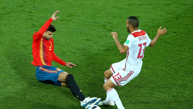 Gerard Pique launches into a two-footed tackle