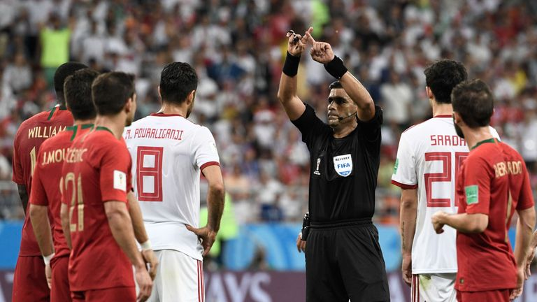 The referee calls for VAR during Portugal's clash with Morocco