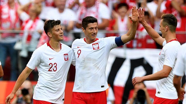 Robert Lewandowski celebrates his double against Lithuania