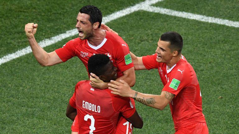 Blerim Dzemaili (L) celebrates after scoring against Costa Rica