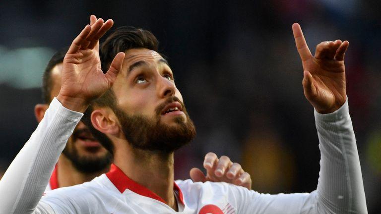 Turkey's Yunus Malli celebrates after scoring against Russia