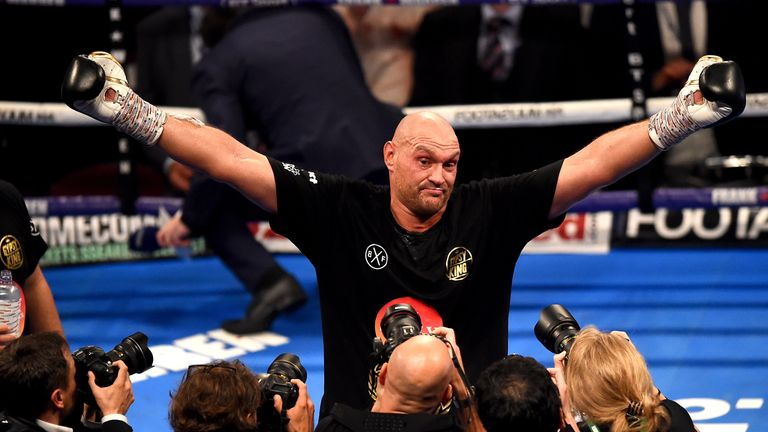 Tyson Fury celebrates after a comfortable win in his comeback fight