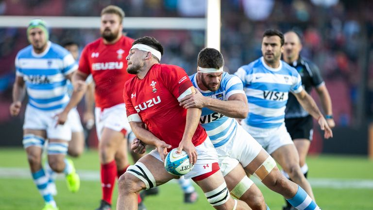 Ellis Jenkins (front-L) from Wales is tackled by Argentina's Marcos Kremer