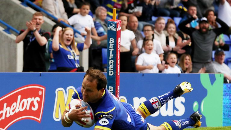 Tyrone Roberts dives over the line for Warrington's first try