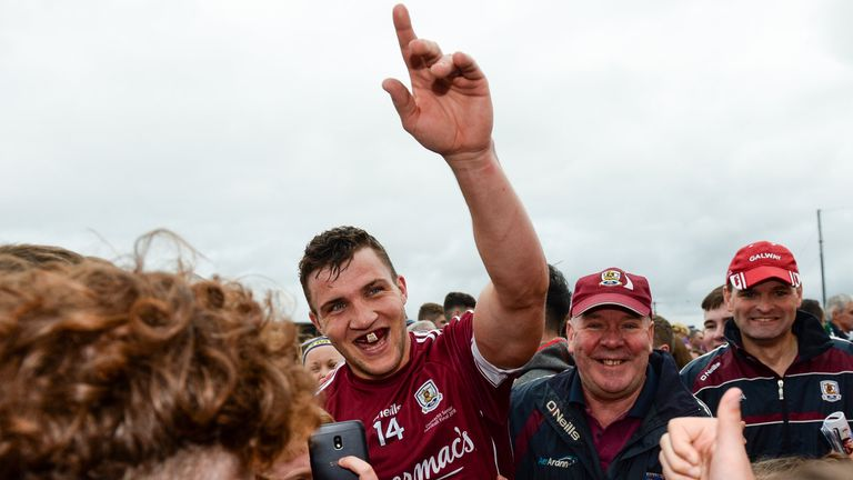 Damien Comer celebrates at the final whistle