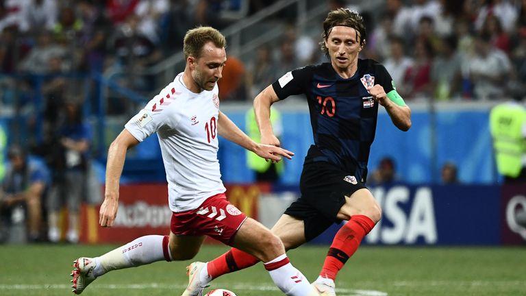 Christian Eriksen and Luka Modric battle for possession