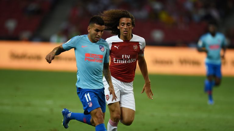 Angel Correa shields the ball from Matteo Guendouzi in the first half