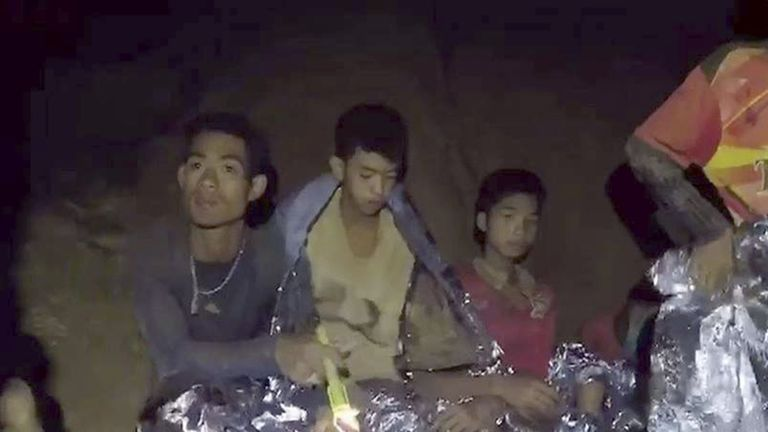 Members of the young boys' football team are seen in the cave in Chiang Rai, Thailand, on July 4