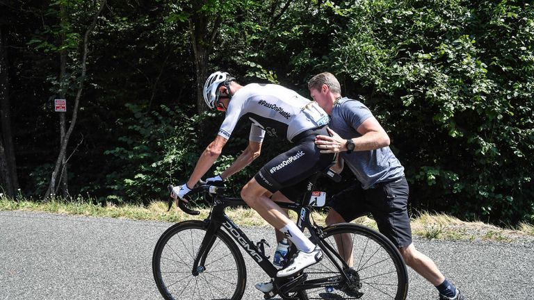 Man jumps bike over Tour de France riders