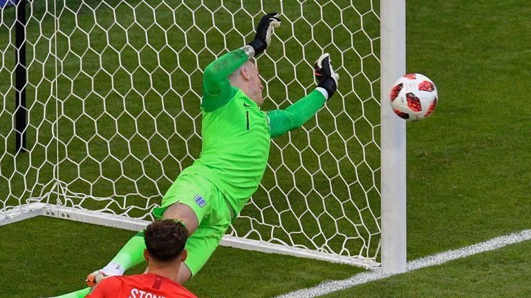 Jordan Pickford tips away Marcus Berg's header