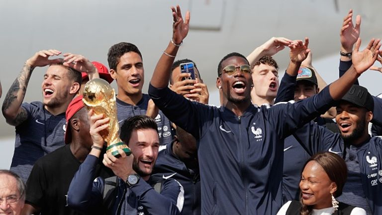 The victorious France squad celebrate after landing in Paris