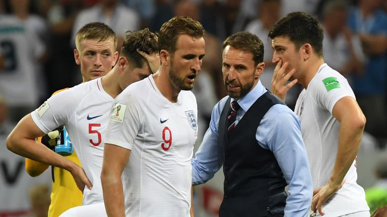Gareth Southgate consoles England captain Harry Kane at the final whistle