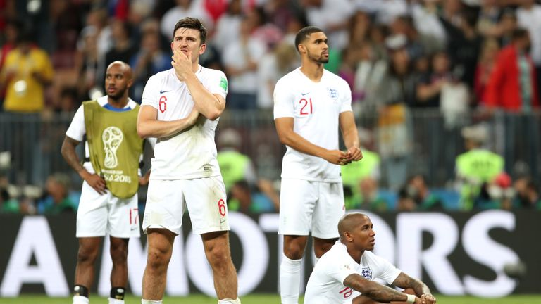 England players stand dejected after their elimination in the semi-finals of the World Cup