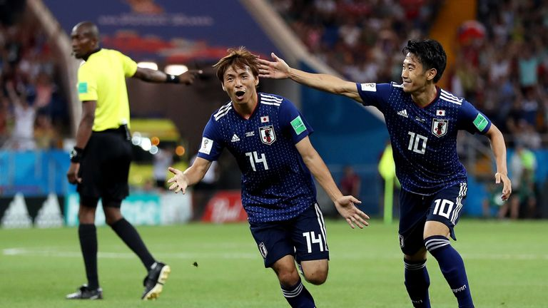Takashi Inui celebrates doubling Japan's lead with a superb strike