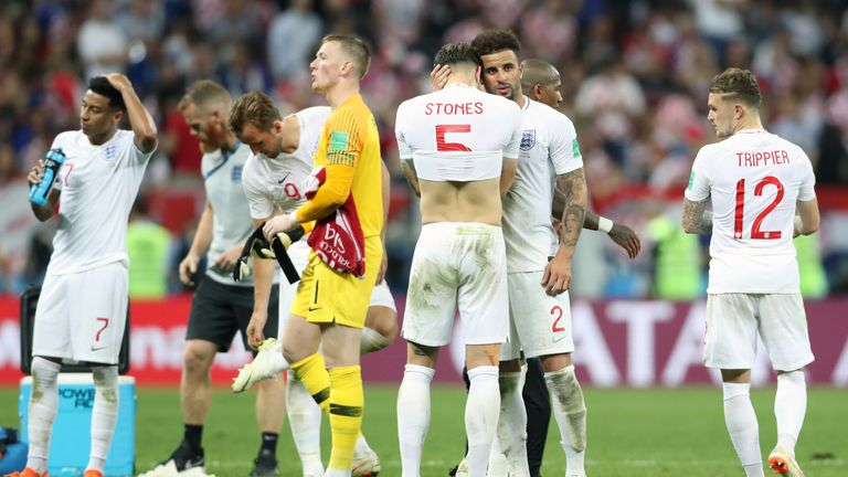John Stones is consoled by Kyle Walker at full-time following England's 2-1 loss to Croatia in the World Cup semi-final