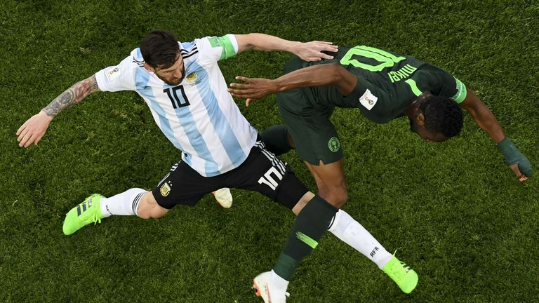 Mikel tussles with Argentina's Lionel Messi just hours after being told his father had been kidnapped