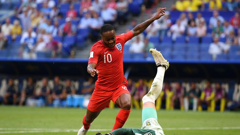 Robin Olsen denies Raheem Sterling in the first half