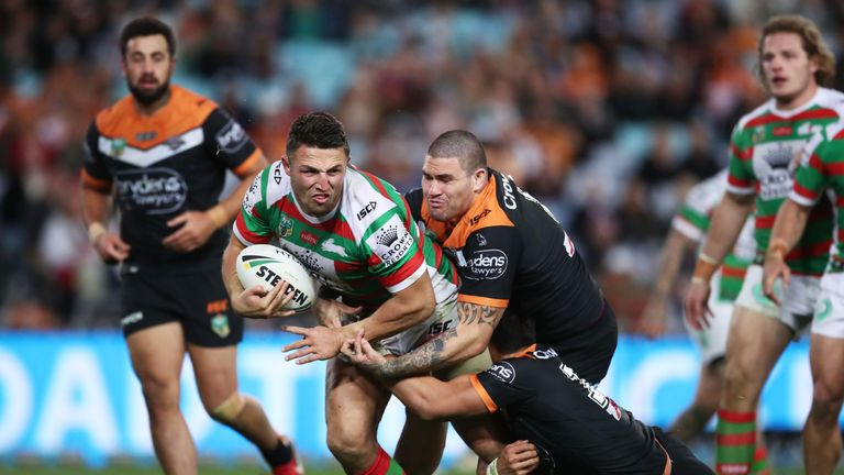 Sam Burgess is tackled during the Rabbitohs' loss to Wests Tigers