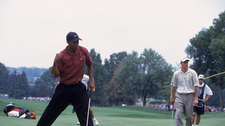 Woods edged out Jim Furyk in a play-off to complete his hat-trick in 2001