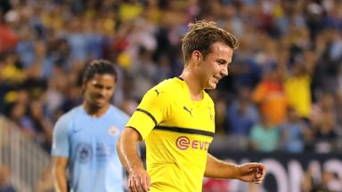 Mario Gotze celebrates after opening the scoring from the spot in Chicago