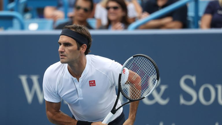 Federer sets up finals clash with Djokovic