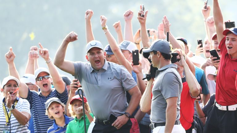 Loud cheers met Rory McIlroy's chip-in at the 14th