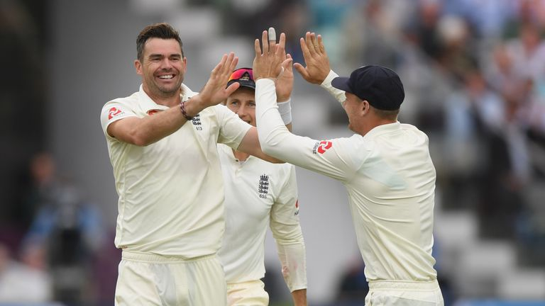 James Anderson celebrates one of his two early wickets on day two