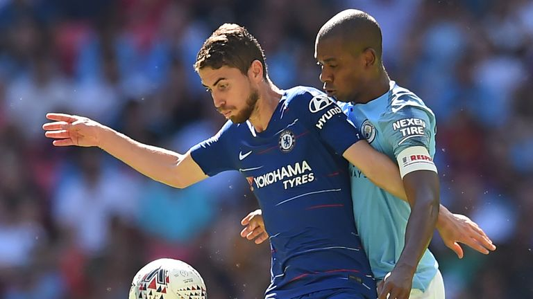Jorginho competes with Fernandinho during the Community Shield