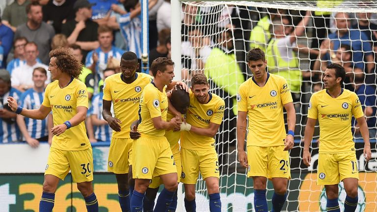N'Golo Kante is mobbed by his Chelsea team-mates