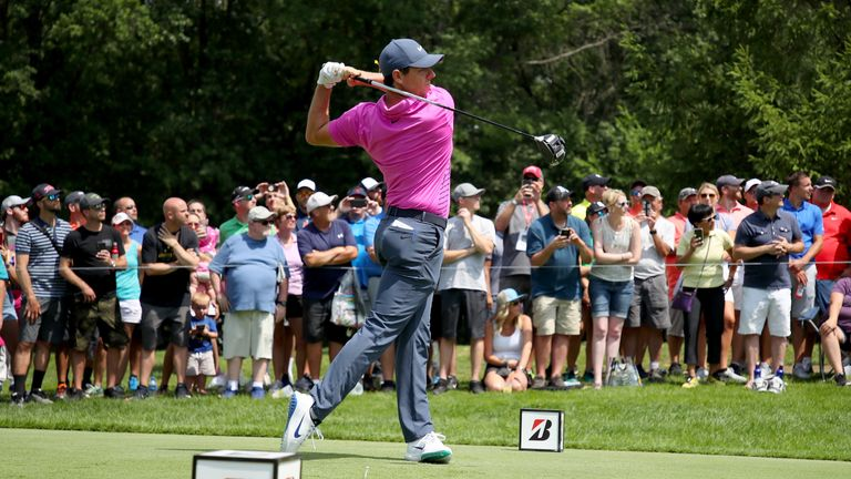 McIlroy's birdie-birdie finish lifted him to within three of the lead