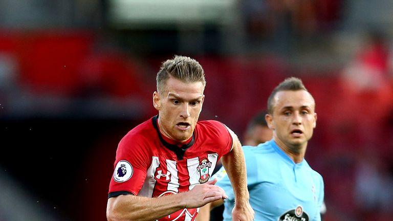 Steven Davis and Stanislav Lobotka battle for the ball during Southampton v Celta Vigo