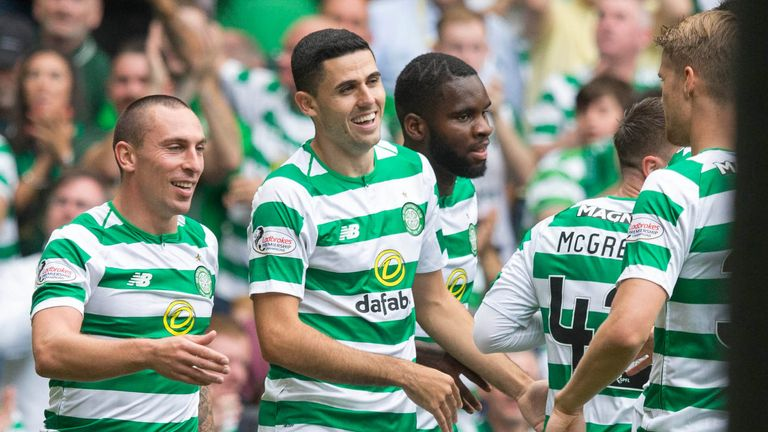 Tom Rogic (second left) celebrates scoring Celtic's opening goal