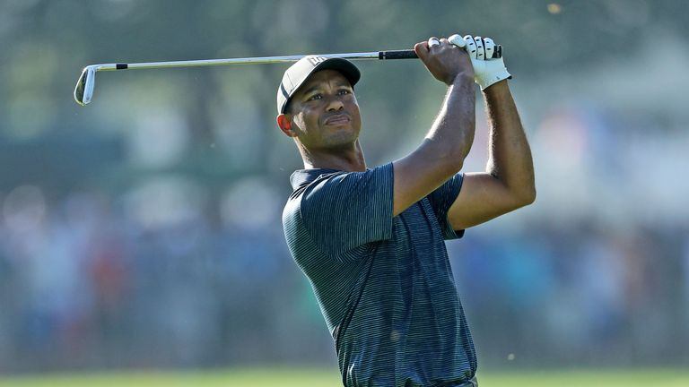 Storm swamps Tiger's charge as Woodland leads rain-hit PGA