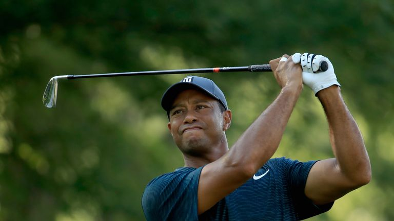 Woods hit a two-under par back nine to finish at level par