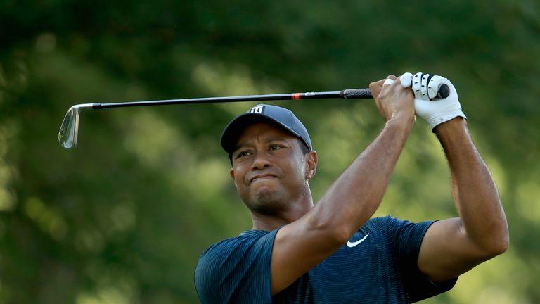 Woods hit a two-under par back nine to finish at level par