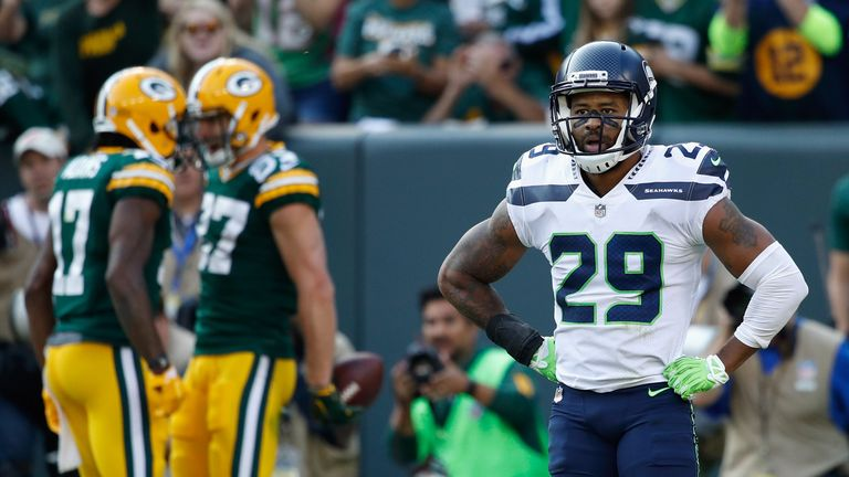 Thomas is ending his holdout with the Seahawks