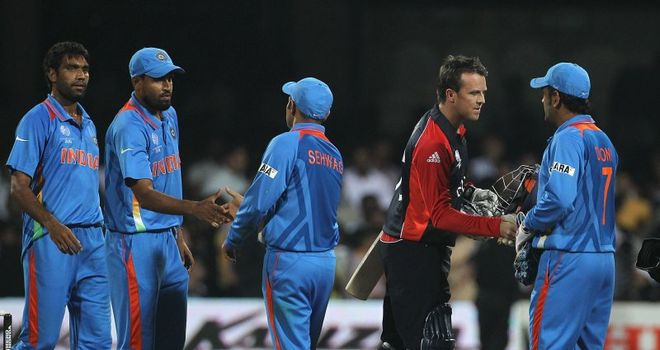England's Graeme Swann shakes hands with the Indian players after their match at the 2011 World Cup ends in a tie