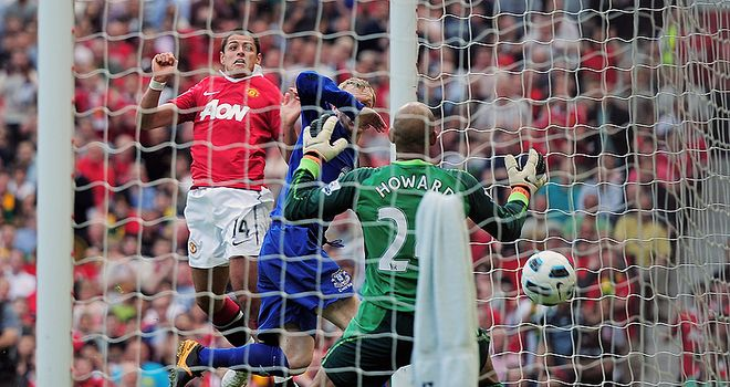 Javier Hernandez rises at the far post to secure United a priceless three points in the race for the title