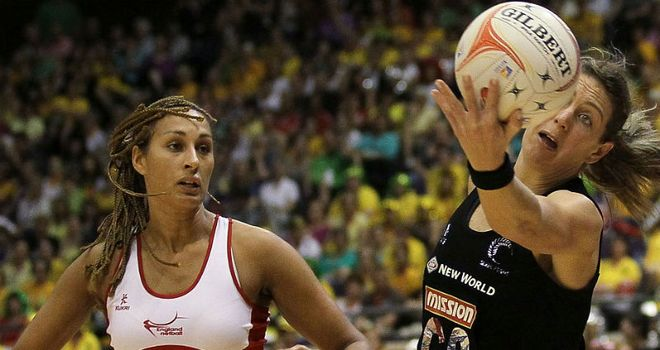 Irene van Dyk of New Zealand tries to keep the ball in play under pressure from England's Geva Mentor