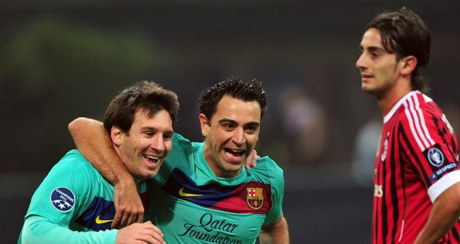 Lionel Messi (L): 'Maybe the best of all time' according to team-mate Xavi