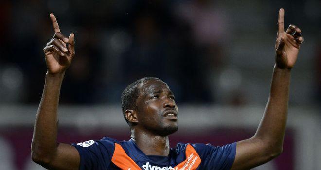 Title clincher: John Utaka celebrates scoring for Montpellier against Auxerre