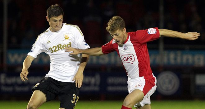 Davies and Clarke: Battling for the ball