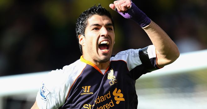 Suarez: Celebrates one his his three goals at Carrow Road